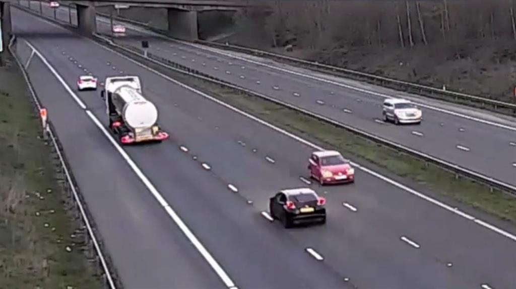 Near miss: The red Polo driven by Emma Marshall-Davies (pictured) on the M4 PICTURE: WALES NEWS