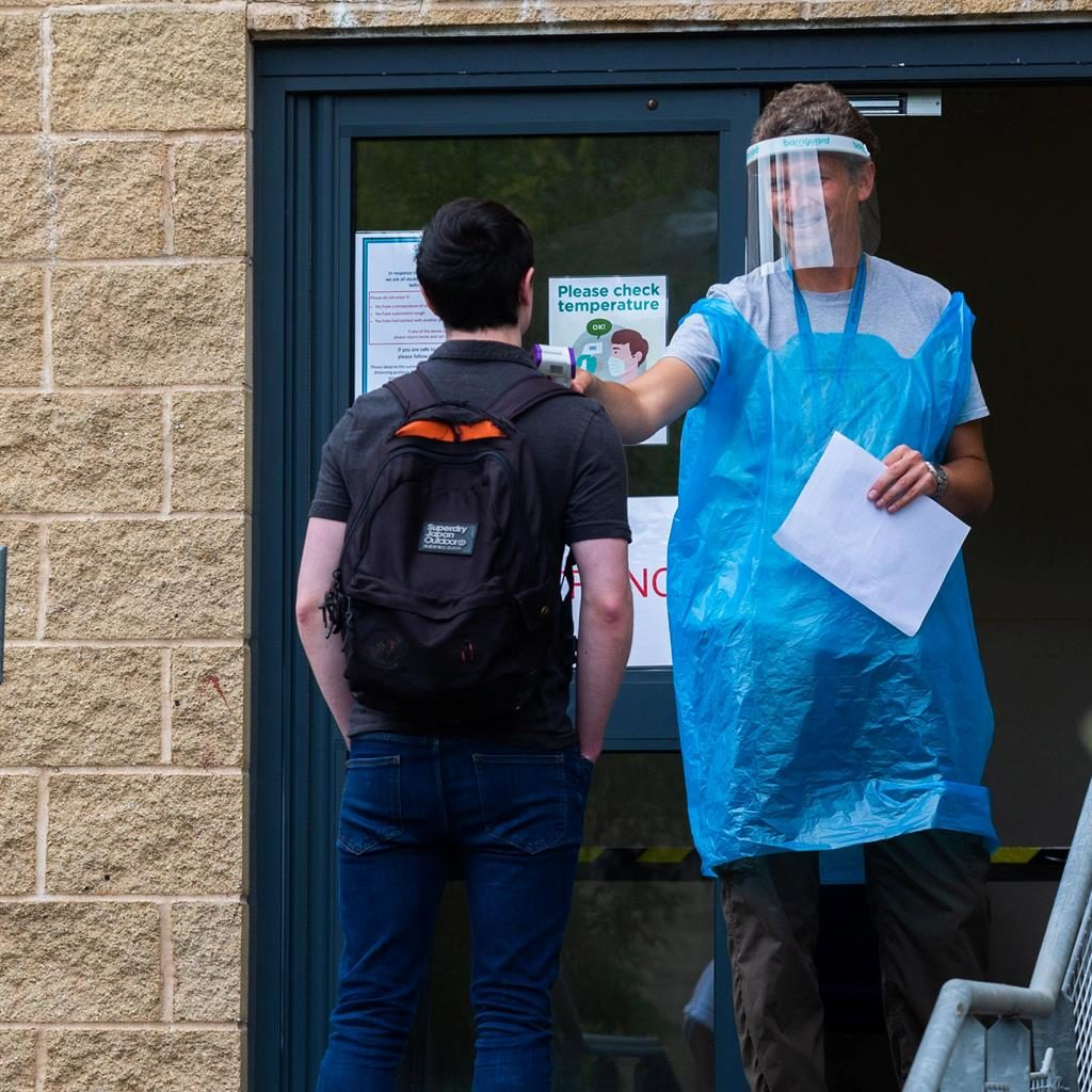 PPE lesson: A teacher takes the temperature of pupils at Lipson Co-operative Academy in Devon