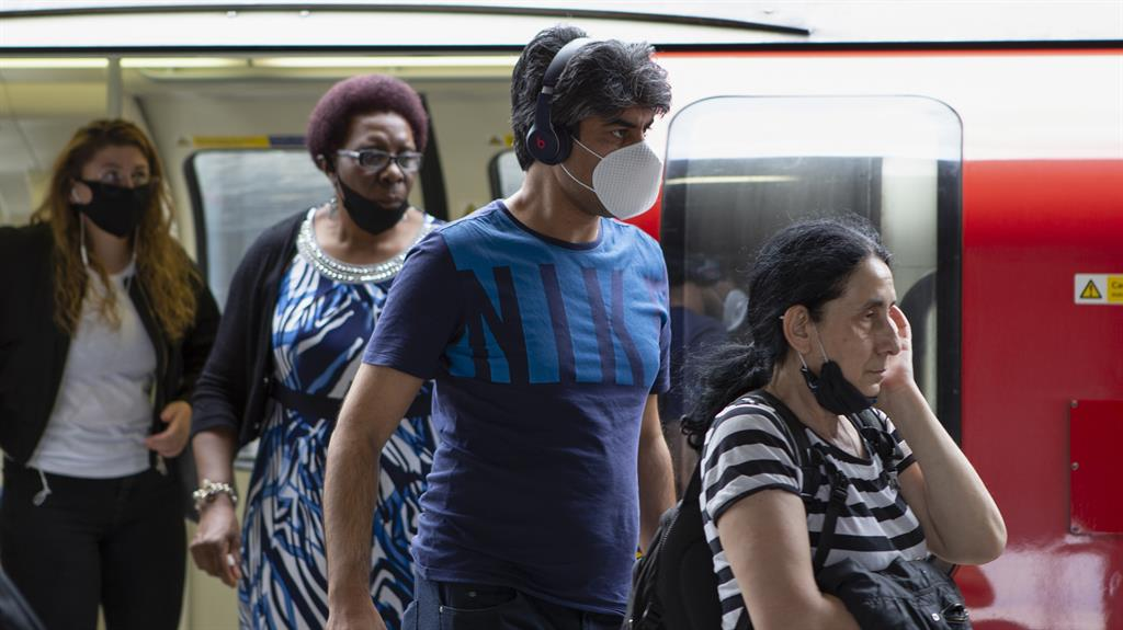 Taking it on the chin: Passengers wearing masks on the Tube PICTURE: MI NEWS