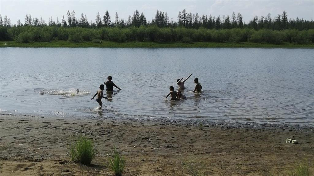 Cooling off: Youngsters in Siberian town Verkhoyansky, 60 miles inside Arctic Circle PICTURE: AP
