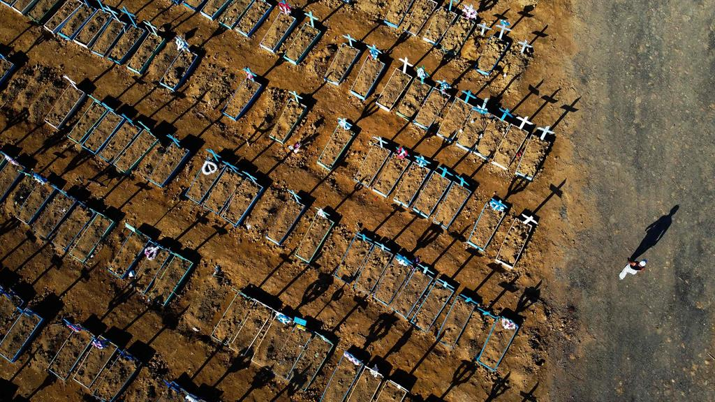 Infection crisis: Lines of new graves at Nossa Senhora Aparecida cemetery in Manaus, north-west Brazil PICTURE: AFP/GETTY