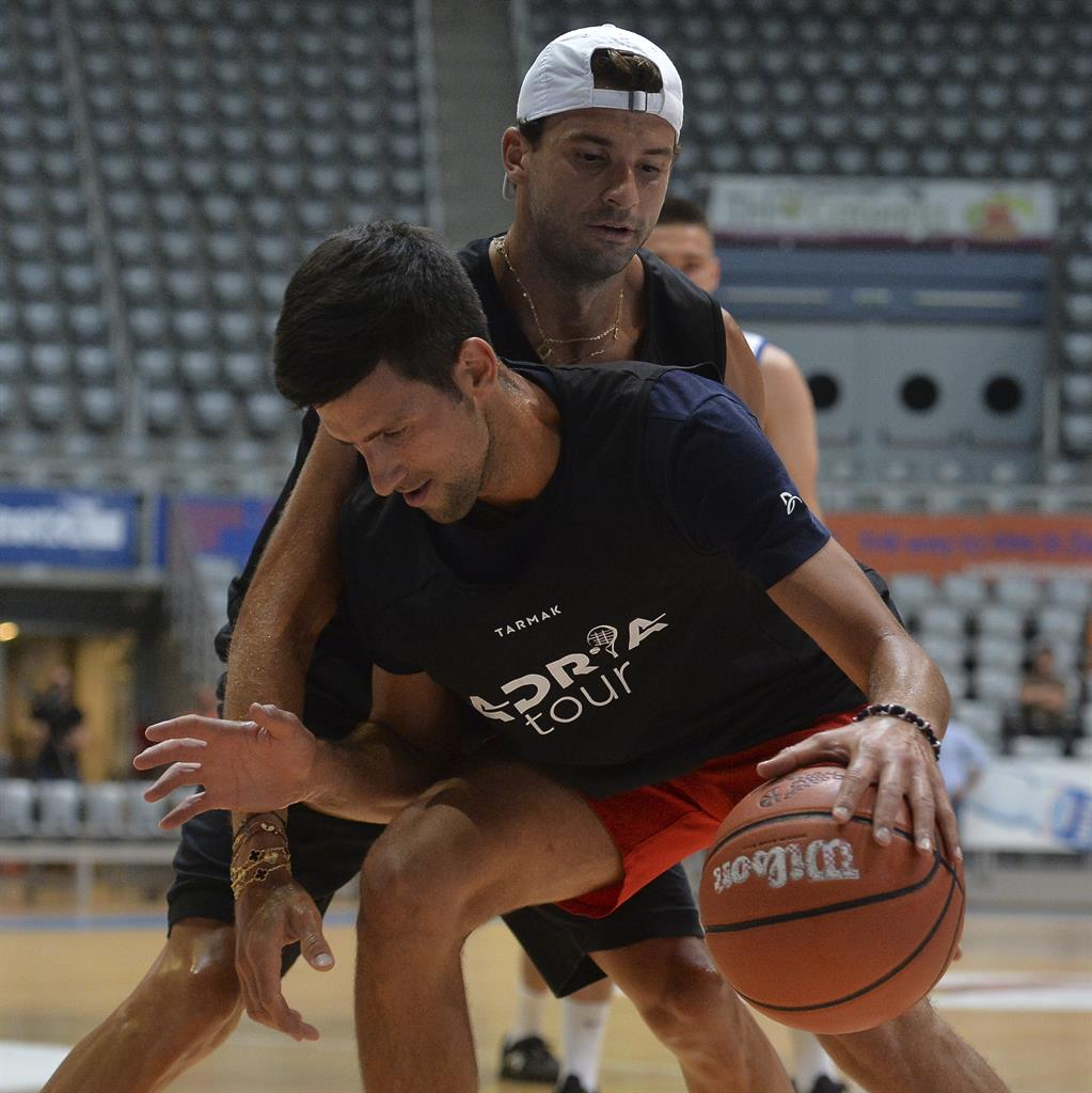 Close contact: Djokovic plays a game of basketball with Dimitrov (top) in Zadar PICTURE: AP