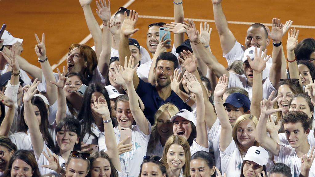 Criticism: Novak Djokovic with volunteers and players after the tournament PICTURE: AP
