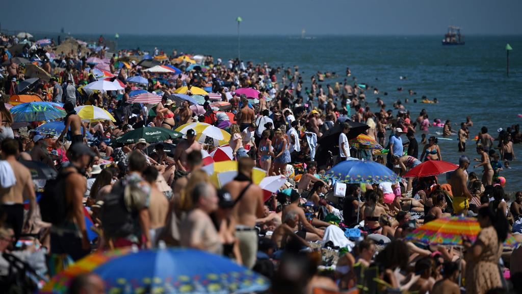 Crush hour: Sun worshippers packed the beach at Southend yesterday, while visitors to Broadstairs (inset) observed social distancing PICTURES: DUNCAN MCGLYNN/GETTY/REX