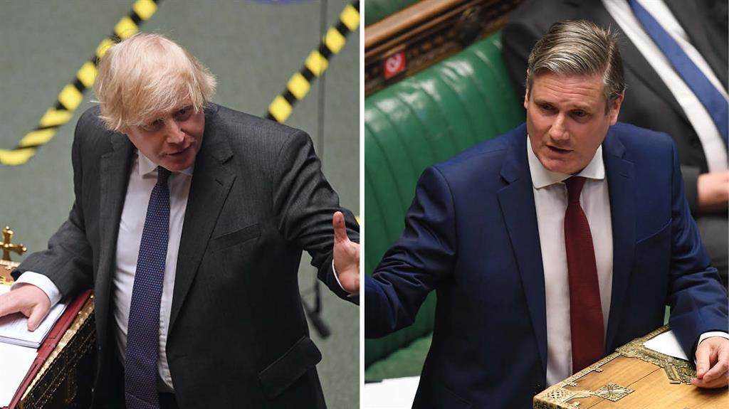 Under fire: Boris Johnson at PMQs yesterday as Labour's Sir Keir Starmer responds