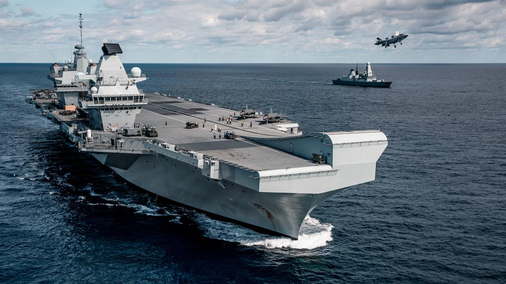 Jewel in the crown: A F-35 fighter jet takes off from HMS Queen Elizabeth PICTURE: MOD/PA