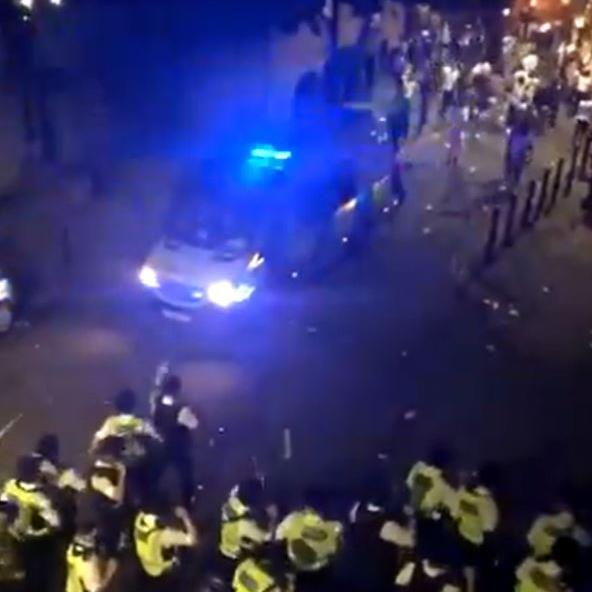 Police officers attacked at illegal London street party
