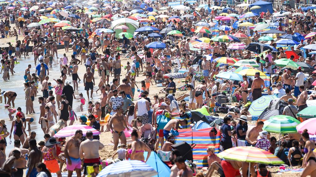 Pack it in! Bournemouth beach yesterday PICTURES: BNPS/GETTY/BPM/LIVERPOOL ECHO/PA