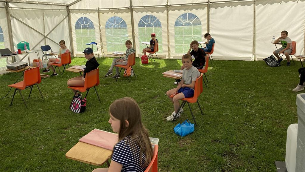 Tent-ative return: St Paul's school in Kent set up a marquee for socially distanced classes PICTURES: ST PAUL'S CHURCH OF ENGLAND/SWNS