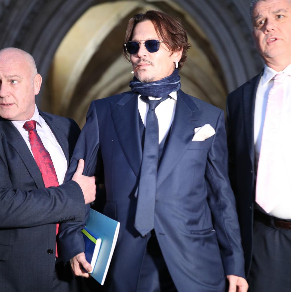 Suing: Depp has taken legal action PICTURES: PA