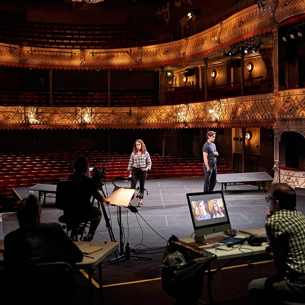The social distance between them: Foy and Smith are filmed on stage at the empty Old Vic PICTURE: MANUEL HARLAN