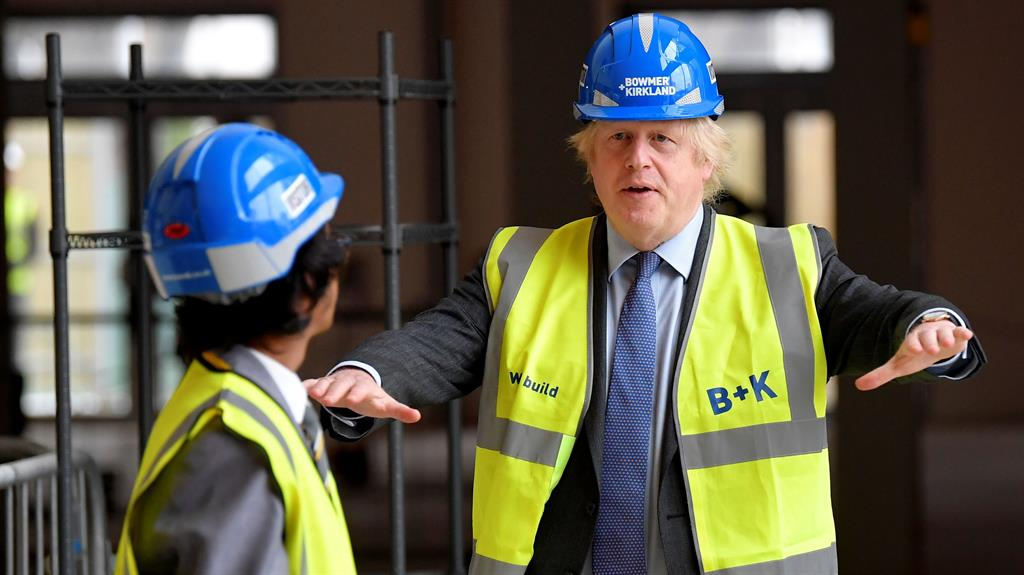 Pledge: The PM visits Ealing Fields High School in west London, where a new teaching block is being built PICTURE: AFP
