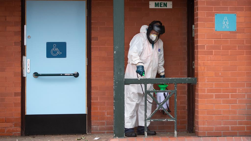 Spray it again: A council worker disinfects public toilets in Leicester yesterday PICTURE: PA