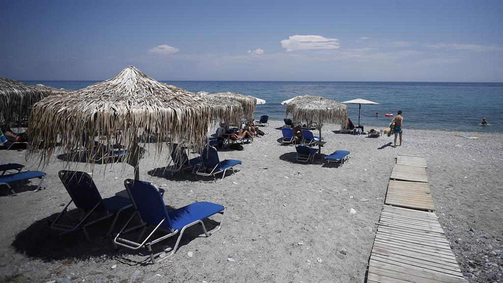 Loungers abound: Leptokarya Beach in the east of Greece remains almost bereft of tourists PICTURE: EPA