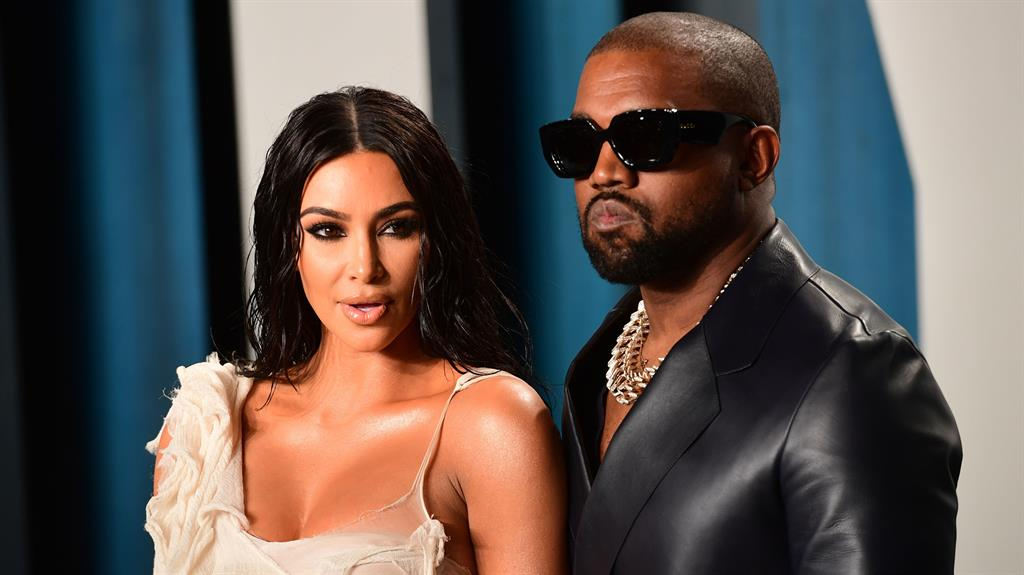 Lucrative lovers: Kanye says his wife Kim, left, has joined him in the billionaires club PICTURE: PA