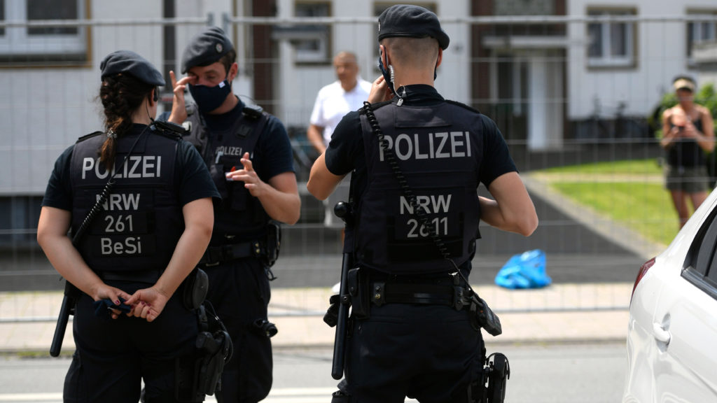 On guard: Police outside workers' homes PICTURE: AFP/GETTY