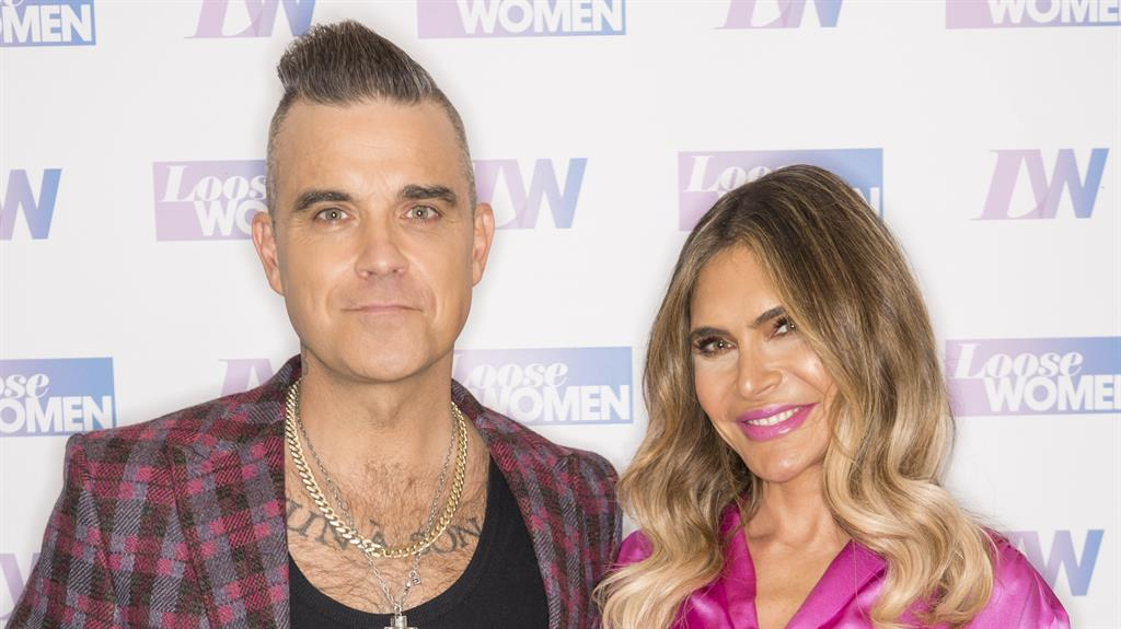 Charity work: Both Robbie and his wife Ayda were warned off PICTURE: REX