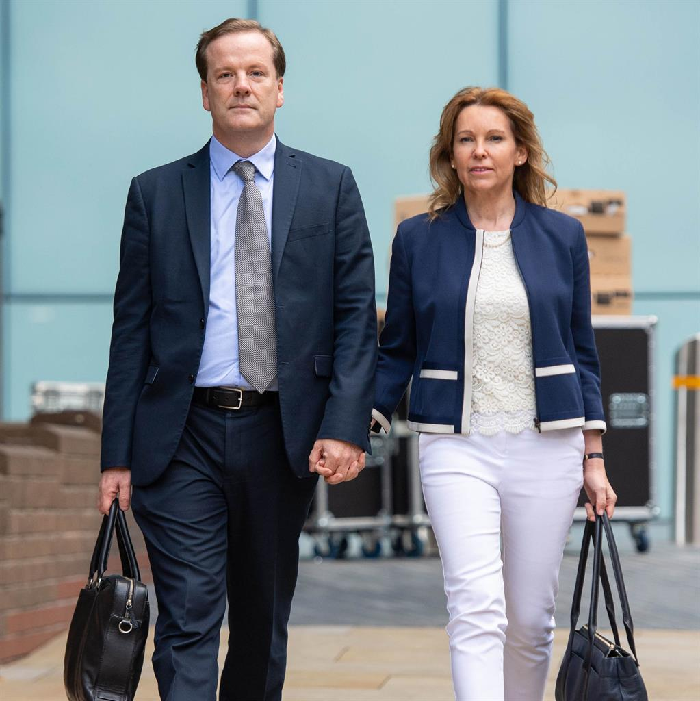 Denies all charges: Charlie Elphicke with his wife Natalie PICTURE: PA