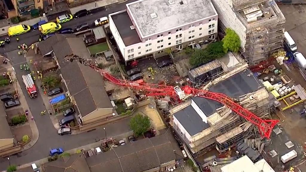 London crane collapse: Major incident as house crushed with people trapped inside