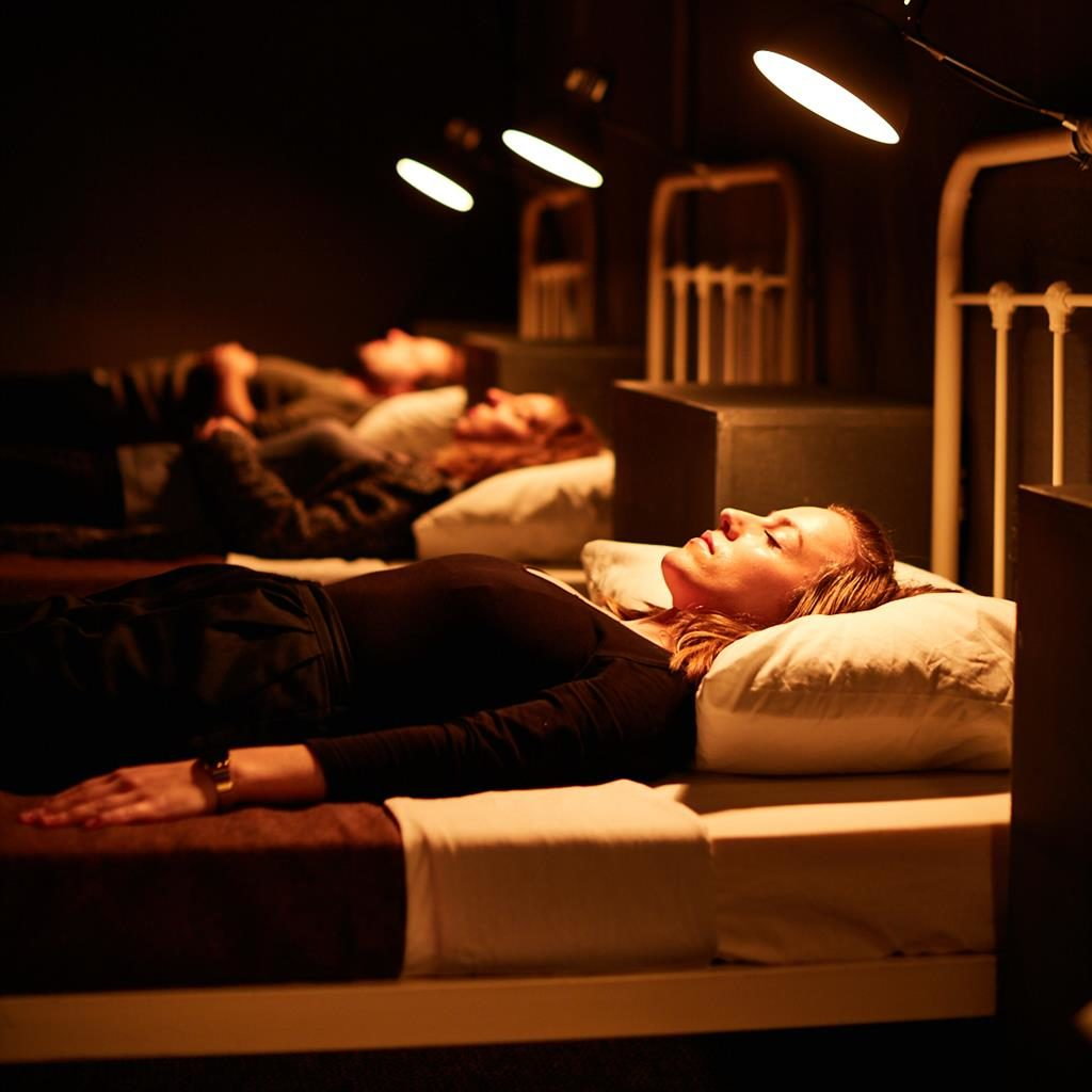 In theatre: Viewers at stage version lie down (above) as if on the ward PICTURE: DAVID LINDSAY