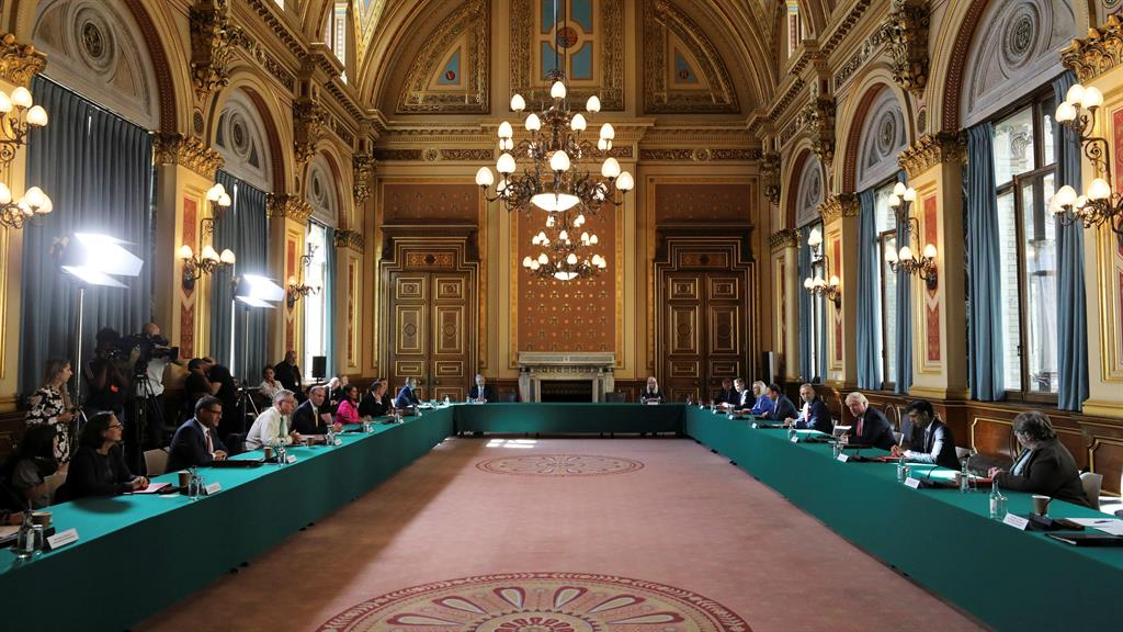 Grand gesture: The meeting was held in the Foreign Office's Locarno Suite, with the PM warning of difficult times ahead PICTURES: PA/GETTY