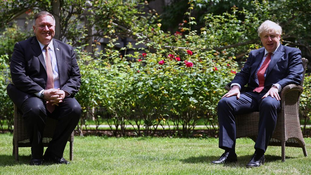 Close to a deal: But Mr Pompeo and the PM kept their distance in the gardens of No.10 yesterday PICTURE: AFP/GETTY