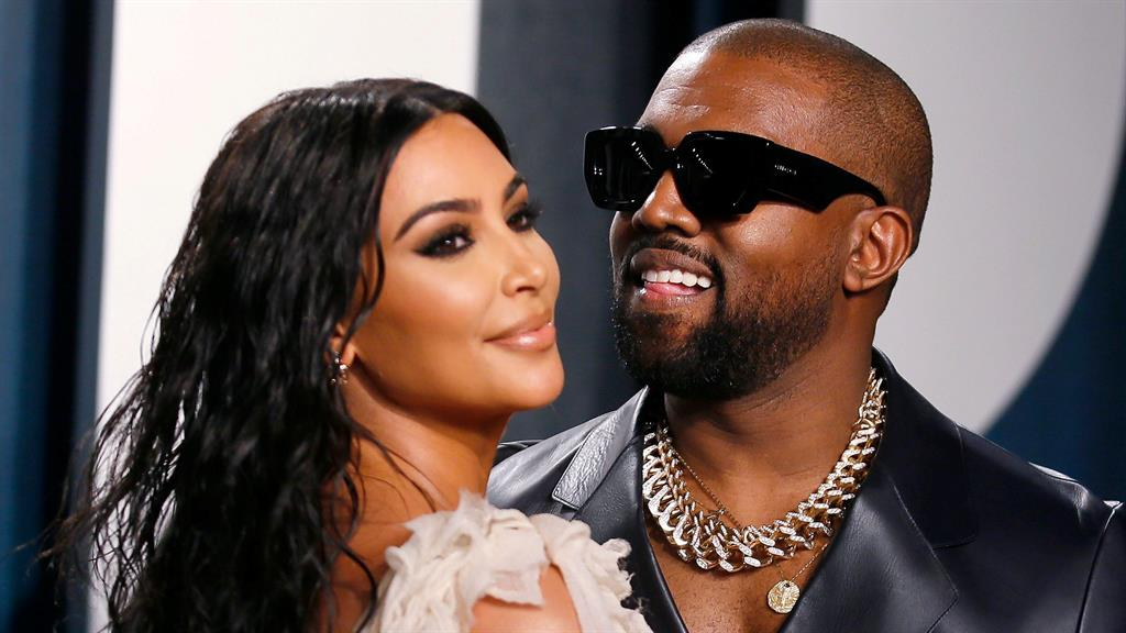 Happy together: Kim and Kanye at Vanity Fair Oscars party in February PICTURE: REUTERS