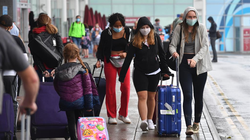 Anger: Passengers at Birmingham Airport. Travellers from Spain must isolate PICTURE: PA