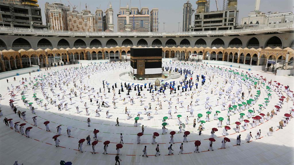 Special measures: The Grand Mosque was much less crowded than last year (below) PICTURES: GETTY