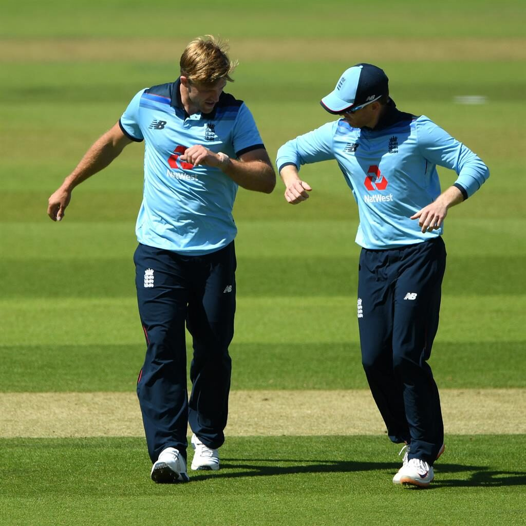 Welcome back: Willey (left) celebrates with Morgan after taking the wicket of Gareth Delany yesterday