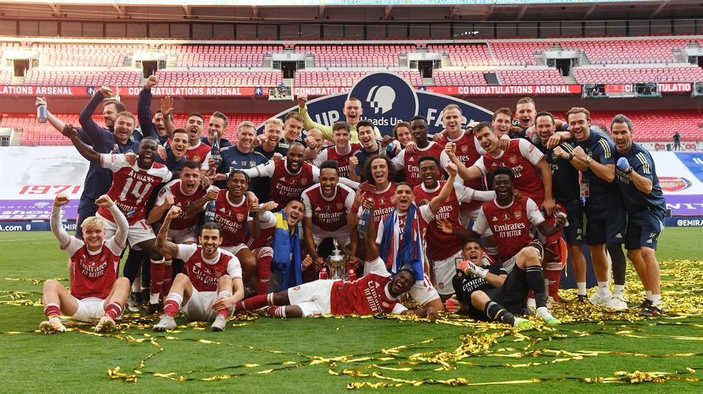 Final flourish: Arsenal celebrate their 14th triumph