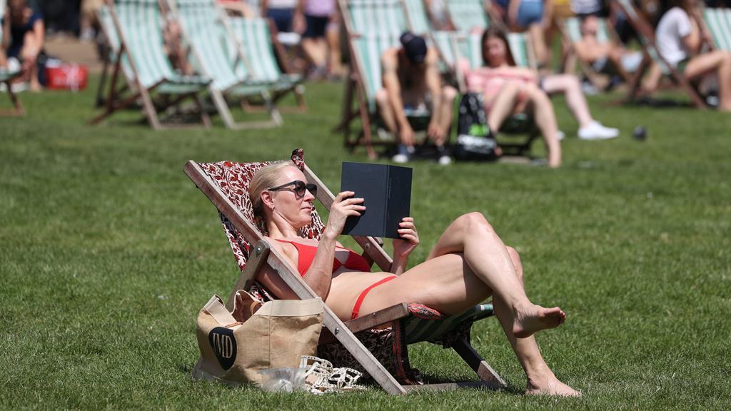 Soak up sun: Sunbathing in London PICTURE: PA