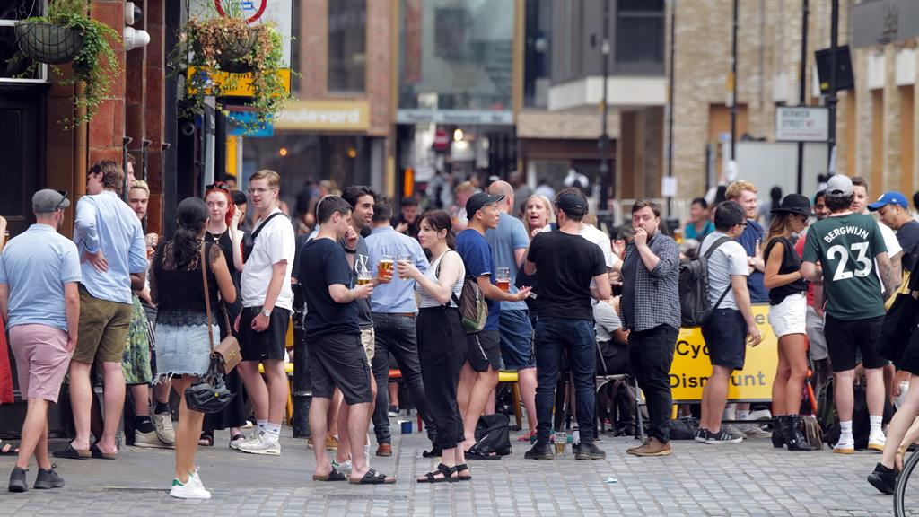 Street party: There's little sign of social distancing as drinkers flock around Soho's pubs and restaurants PICTURE: SPLASH NEWS