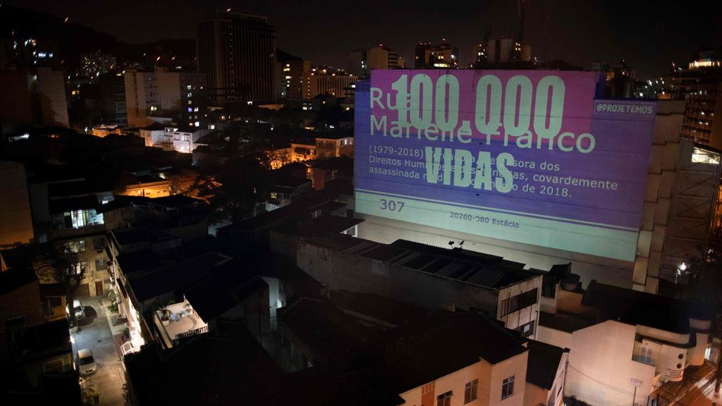 Tribute: A projection on a building honours the 100,000 victims who have died of Covid-19 in Rio de Janeiro, Brazil PICTURE: GETTY