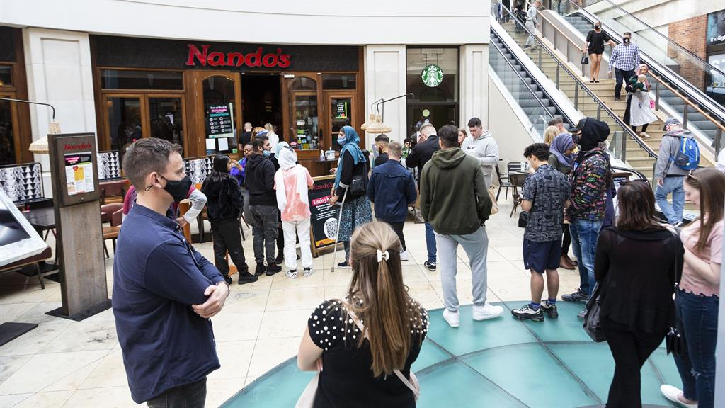 No chickening out: Diners face a long wait outside a Nando's restaurant in Leeds yesterday PICTURE: SWNS