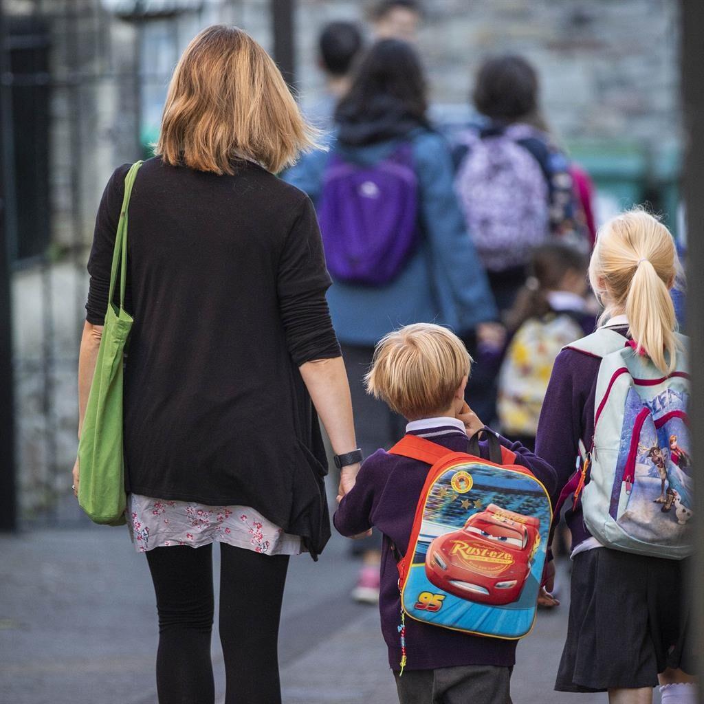Return to class: Children at Bishop Road Primary School in Bristol PICTURE: SWNS