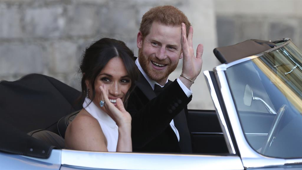 Wavy train: Meghan and Harry after their £32million wedding in 2018 PICTURE: AP