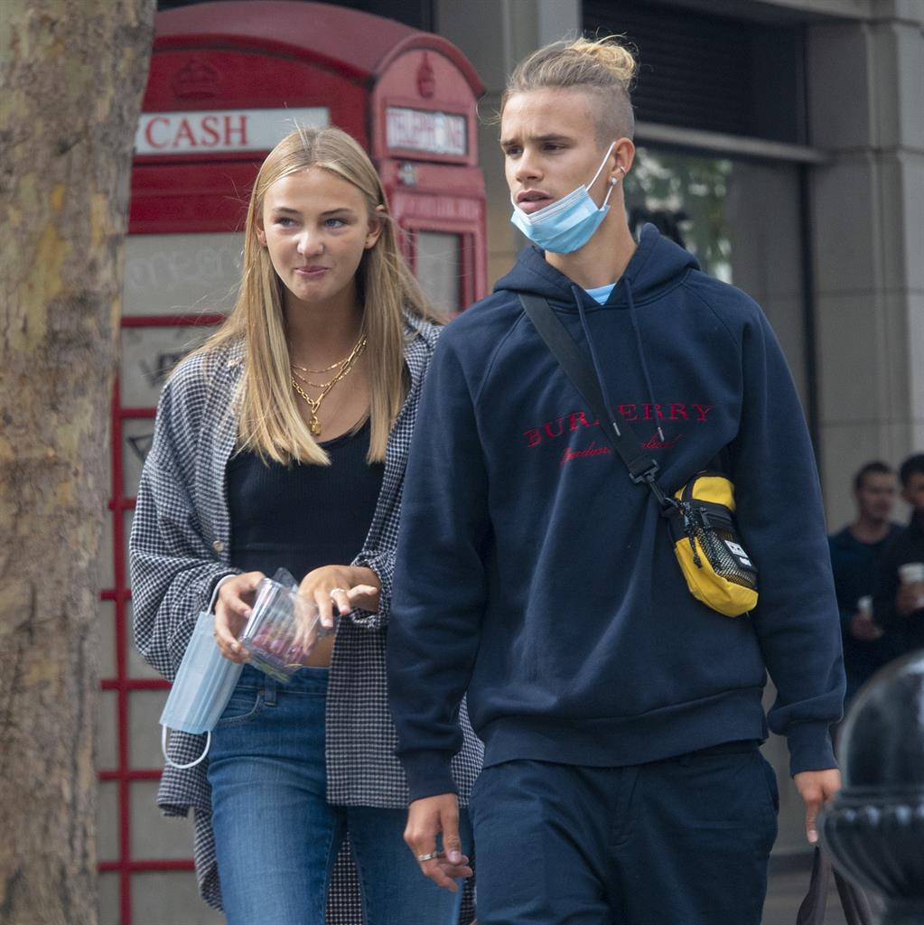 Wherefore mask thou Romeo? Young Beckham and Mia shopping in Sloane Square PICTURE: MJ PICTURES