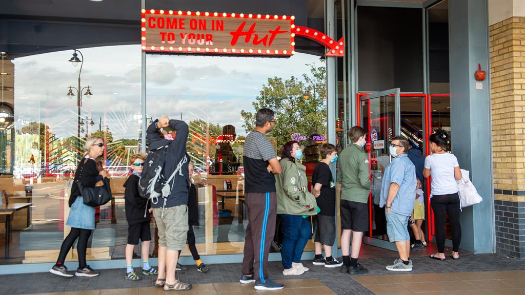 Boost: A queue forms outside a Pizza Hut during the Eat Out to Help Out scheme but it  hasn't  been enough to reverse the damage of the pandemic PICTURE: REX