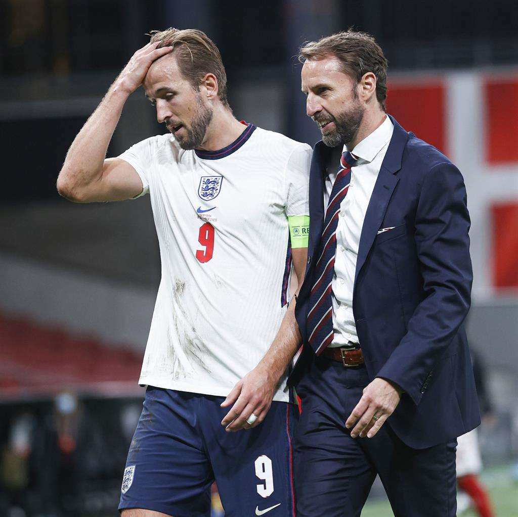 Support: Kane (left) backed England boss Southgate (right) and hopes Greenwood and Foden (below) 'learn' after being sent home