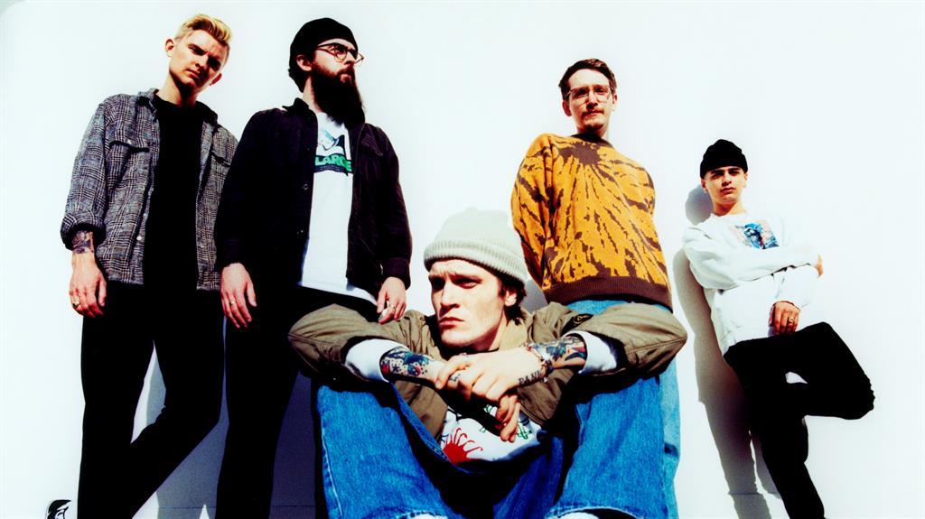 Cool concept: Ben (centre) with Neck Deep bandmates (from left) Sam Bowden, Matt West, Seb Barlow and Dani Washington