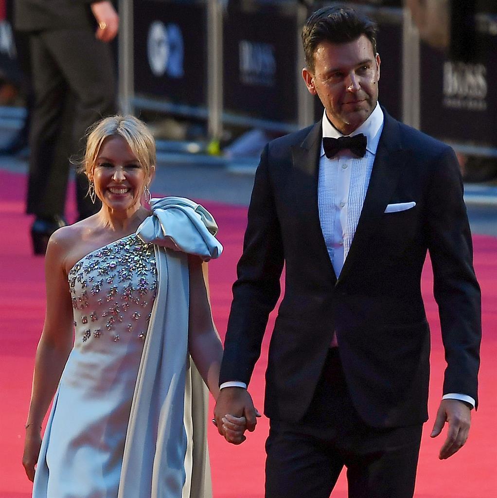 Kylie Minogue Waves A Little 'Magic' At Her Fans