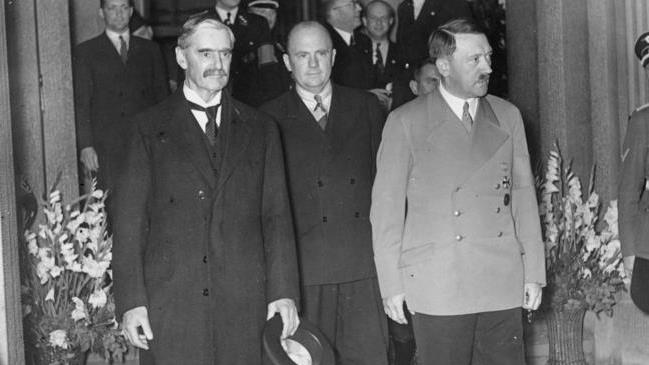 Peacemaker: Neville Chamberlain (left) wanted to avoid war at all costs but Adolf Hitler (right) felt differently PICTURE: GERMAN FEDERAL ARCHIVES
