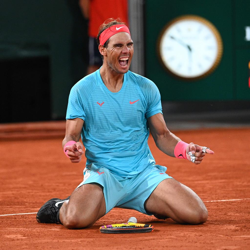 Leveller: Nadal falls to his knees after equalling Federer's record of 20 grandslam titles at Roland Garros yesterday PICTURE: GETTY