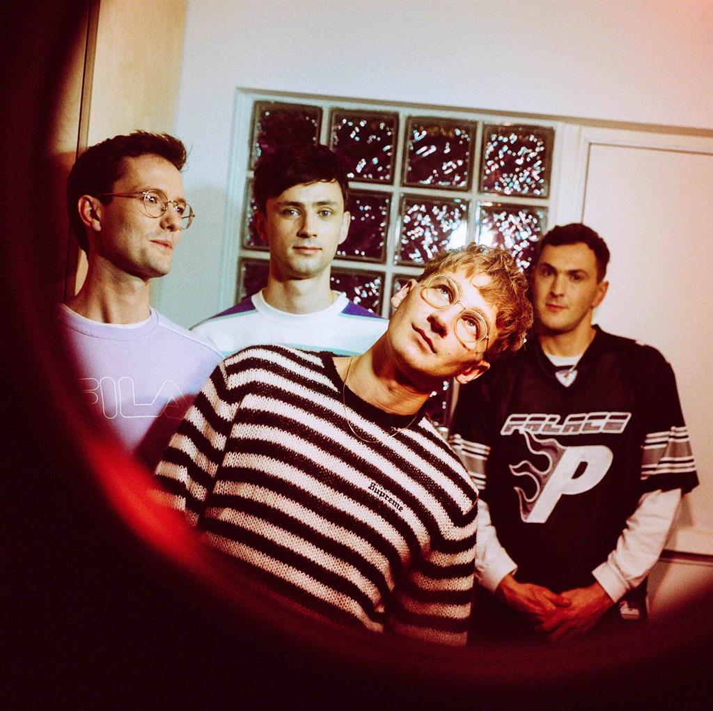 First glass: Dave (centre) with Glass Animals (from left): Drew MacFarlane, Ed Irwin-Singer and Joe Seaward