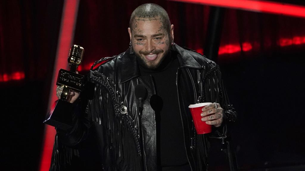 Top spot: Post Malone celebrates his win PICTURES: AP
