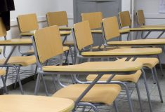 a room full of beech wood exam chairs