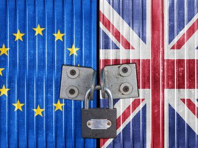 A padlock holds together two metal doors, one painted with the EU flag and one with the UK flag