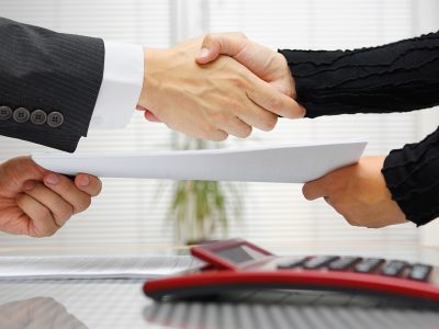 Two professionals shake hands having completed a successful interview
