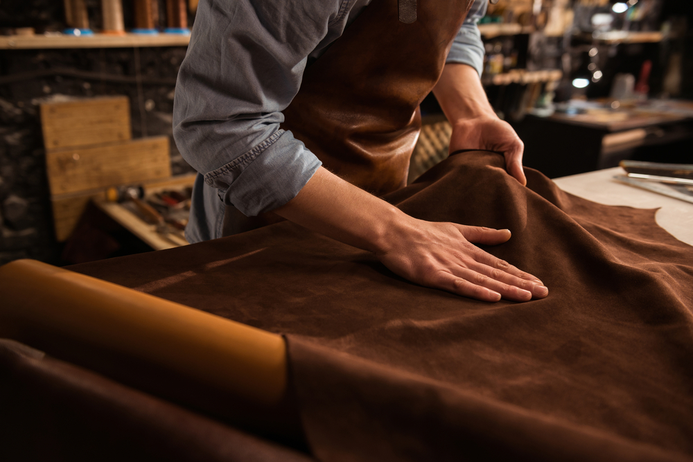 small business space - someone cutting cloth in a workshop